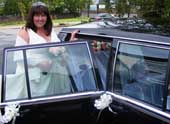 Bride with wedding limousine